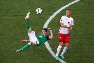 Lafferty attempts an overhead kick.