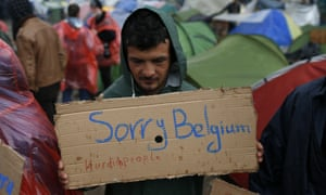 In a protest demanding the opening of the border between Greece and Macedonia in the northern Greek border station of Idomeni in Greece, a migrant holds a a sign in sympathy