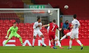 Liverpool's James Milner shoots at goal.