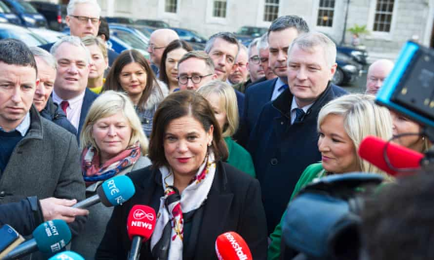 Sinn Féin president, Mary Lou McDonald, centre, with newly elected party members outside parliament in Dublin, Ireland.