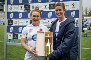 England's Megan Jones is presented with the Player of the Match Award by Sarah Hunter.