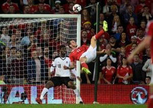 Wales' Gareth Bale almost adds a second with an overhead kick.