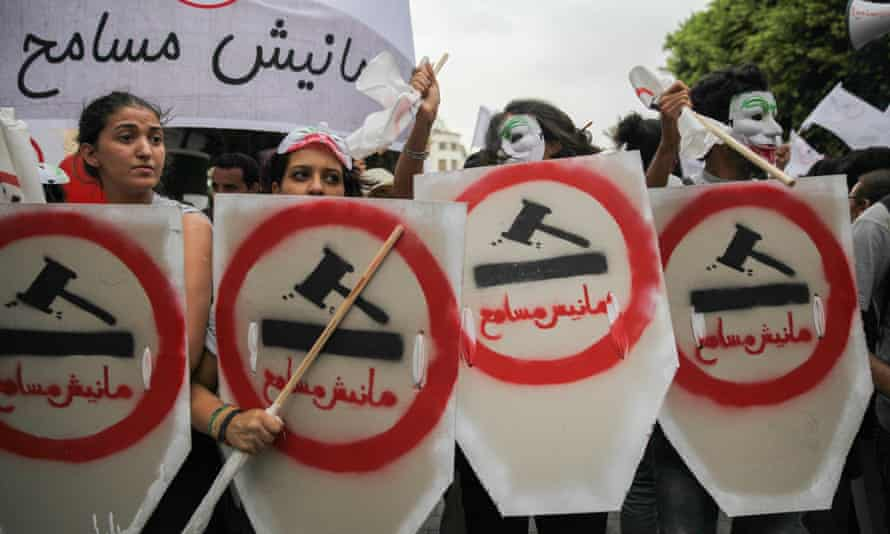 Female demonstrators take to the streets of Tunis to protest against the government's controversial reconciliation act