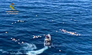 This Spanish police picture shows a speedboat surrounded by bundles of drugs packages, after a police high-speed chase with smugglers off Malaga.