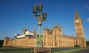 Big Ben and the Houses of Parliament are bathed in morning sunlight in central London