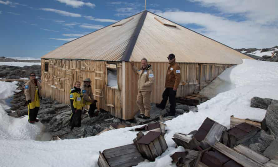 Expeditioners from the Mawson's Hut Foundation near the hut at Cape Denison, Antarctica, on 6 December.