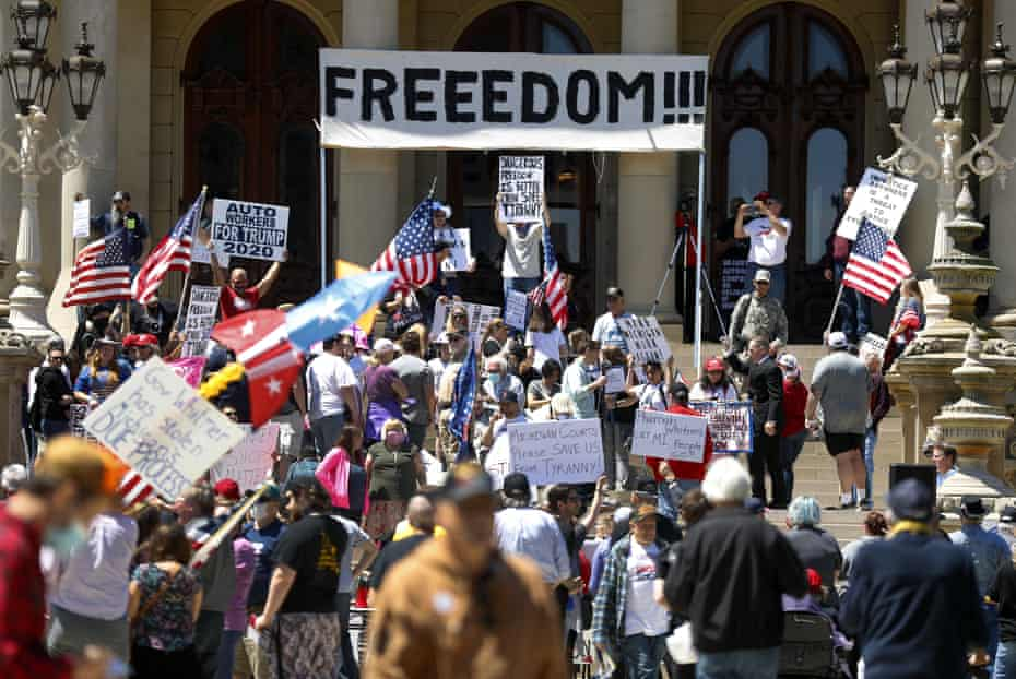 People protest at the state capitol during a rally in Lansing, Michigan, on Wednesday.