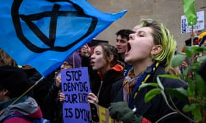 Environmental protesters from the Extinction Rebellion group chant during a demonstration outside BBC Broadcasting House in central London