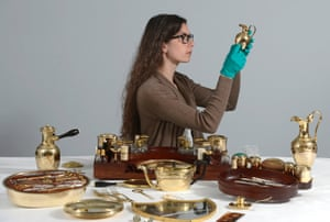 Conservator Isabel Wagner at work on items from the collection.
