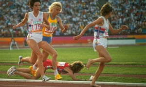 US runner Mary Decker falls to the infield grass after a collision with Zola Budd