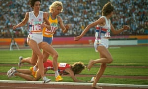 Mary Decker on the ground after a collision with Zola Budd, right, in the women's 3,000m event at the Olympics in Los Angeles in 1984.