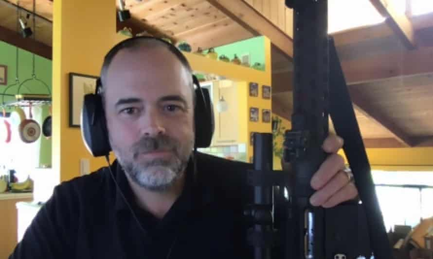 Chuck Rossi holding his rifle during a Zoom gun safety training course.
