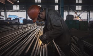 A worker welds steel bars at the Zhong Steel Group Corporation in Changzhou. Steel mills in China boosted output ahead of upcoming production cuts.