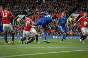 Wes Morgan scores the equaliser against Manchester United at Old Trafford.