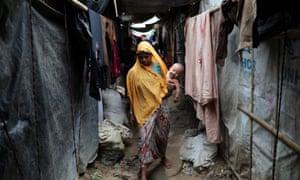 A Rohingya refugee woman walks through the Kutupalong camp in Cox's Bazar in Bangladesh.