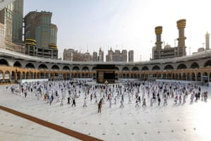Muslim pilgrims circumambulate around the Kaaba, Islam's holiest shrine, at the centre of the Grand Mosque in the holy city of Mecca, while mask-clad and along specific pre-ordained rings as measures due to the coronavirus pandemic, on 2 August, 2020 on the final day of the annual Muslim Hajj pilgrimage.