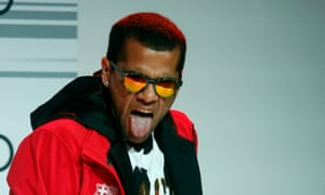 Dani Alves says he sings because he likes to sing. 'I like happiness and when people try to destroy that, it winds me up,' he says.