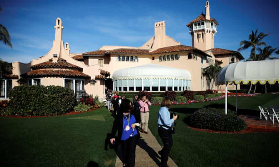 Members of the media are seen at the Mar-a-Lago estate.