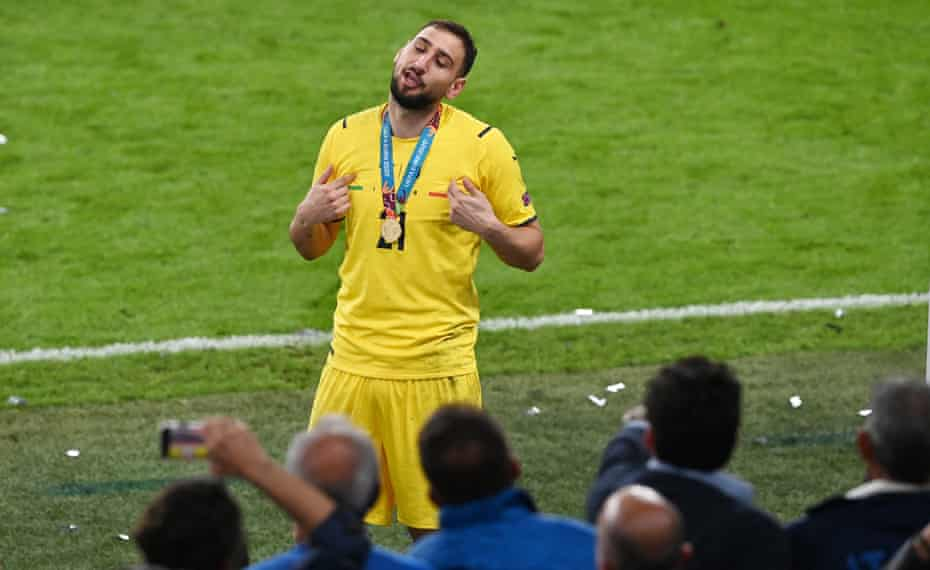Gianluigi Donnarumma celebrates in front of Italy fans at Wembley.