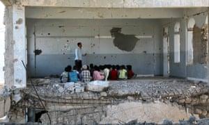 A damaged school in Yemen's third-city of Taez