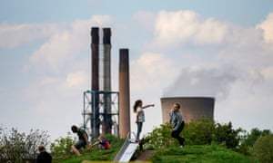 Children play in a park outside the British Steel works in Scunthorpe