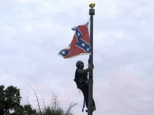 Bree Newsome climbs a flagpole to remove the Confederate battle flag at a Confederate monument in front of the statehouse in Columbia, South Carolina, in 2015.