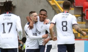Rangers' Ryan Kent (second left) celebrates scoring their first goal with teammates.