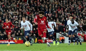 Liverpool's Mo Salah scores his side's second goal from the penalty spot.
