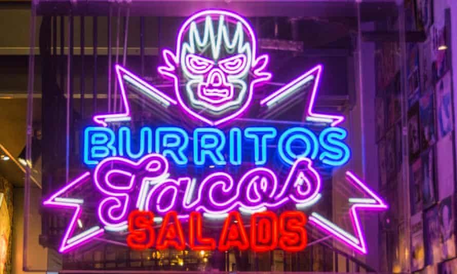 Neon sign in a restaurant window in London.