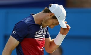 Murray looks dejected as he loses in straight sets.