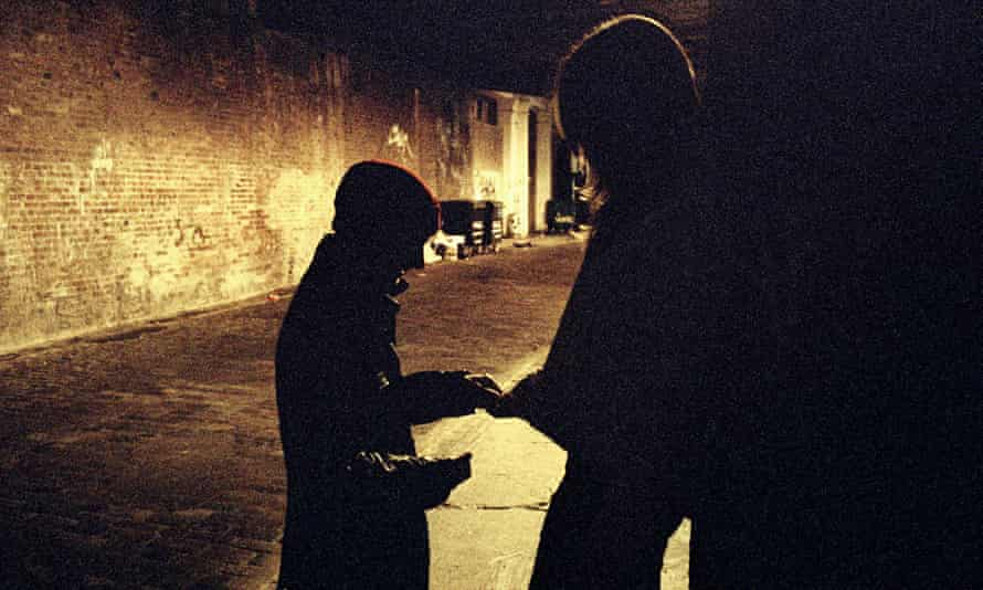 Two people on a dimly lit street