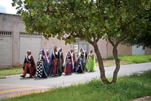 Devotees walk the streets of their community singing prayer songs