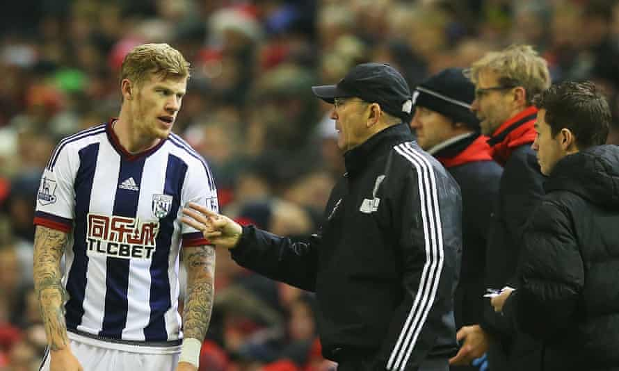 James McClean gets instructions from West Bromwich Albion manager Tony Pulis, with Jürgen Klopp, who repeatedly clashed with Pulis, in the background.
