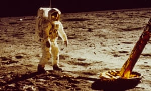 Buzz Aldrin walks on the surface of the moon during the Apollo 11 mission.