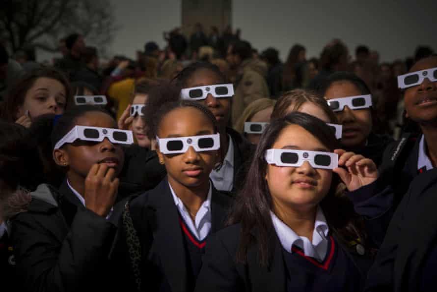 Schoolchildren watch the eclipse at Greenwich Observatory in London