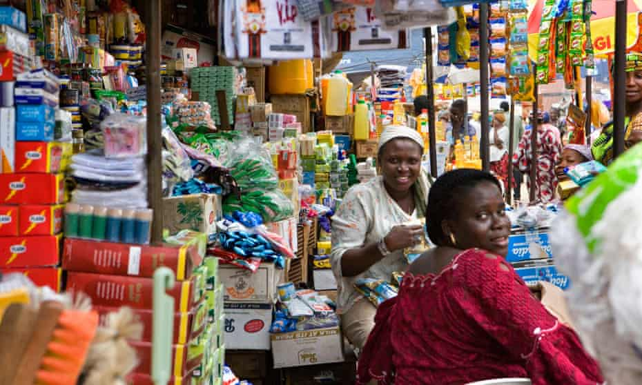 Nigeria Lagos adult women sitting by stall