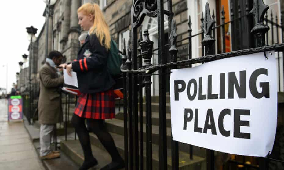 A young voter leaves a polling station in Scotland