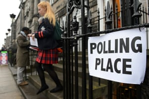 A young voter leaves a polling station after casting her vote in Edinburgh, Scotland, ina referendum for Scotland's independence
