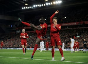 Mané celebrates scoring Liverpool's second goal against Sheffield United with Firmino. The win meant Liverpool had gone a full year without a league defeat.