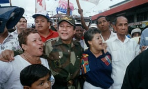 Noriega walks with supporters in the Chorrilo neighbourhood of Panama City in 1989.