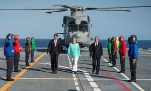 Matteo Renzi (left) François Hollande (right) and Angela Merkel arriving for their meeting in Ventotene.
