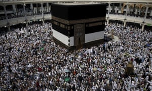 Muslim pilgrims walk around the Kaaba at the Grand Mosque of Mecca