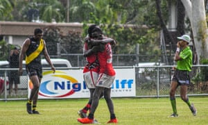 Simon Munkara kicks a goal and then embraces his brother, Dion, during the third quarter of the Bombers clash with Nightcliff