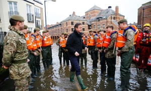 David Cameron meets soldiers working on flood relief in York city centre after the river Ouse burst its banks, in North Yorkshire in January this year
