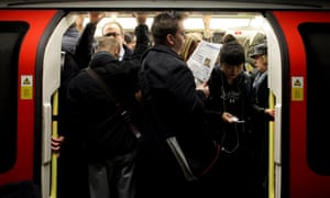Commuters on a crowded tube.