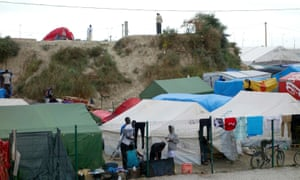 """Makeshift shelters in the camp called the """"Jungle"""" in Calais."""