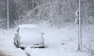 A car is abandoned in snow near Maidstone, Kent