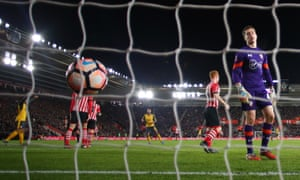 Harry Lewis reacts as Theo Walcott puts Arsenal four goals up at St. Mary's