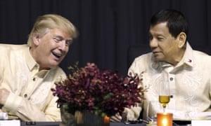 Donald Trump talks with Rodrigo Duterte in 2017.