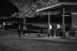 Two teens share a tender moment – before ashen figures run amok.